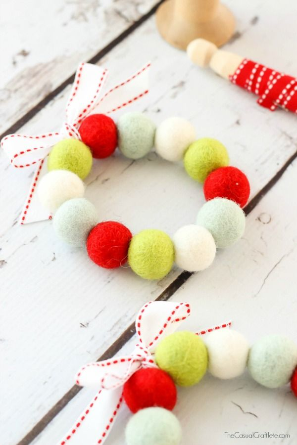 Create an easy to make Felt Ball Wreath this holiday season. Great to use as an ornament for the tree, a Christmas decoration, and more.