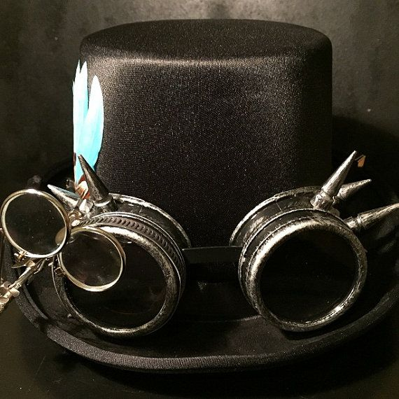 Steampunk - Black Steampunk Top Hat Cyber Punk Retro With Silver Effect Spikey Goggles With Eye Loupes And Turquoise Goose Feather by Steampunkbyben