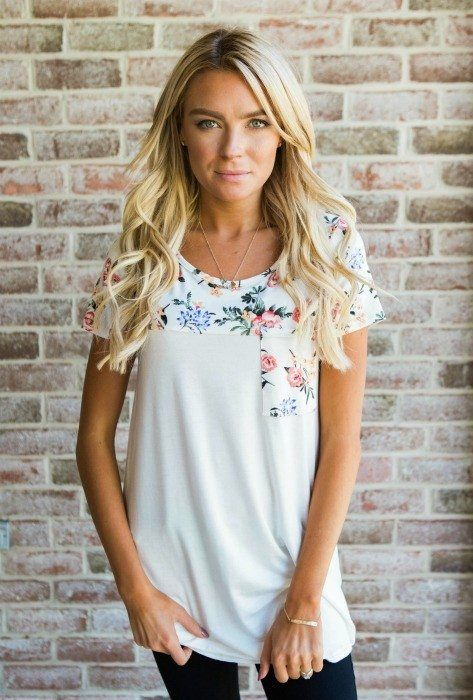 Ivory Floral Pocket Tee New Arrival!! The softest tee with Ivory floral detailing throughout the shoulders and pocket! Buy now! || Bella Ella Boutique
