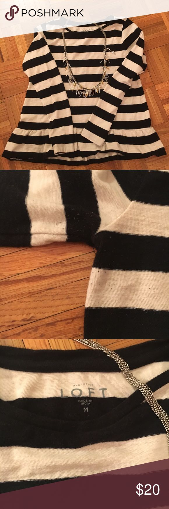 Loft black/white peplum top This is a heavy cotton that is a light sweater material. Worn once this black and white striped sweater/shirt is cute, comfortable and versatile. I'd say it's TTS, I almost always wear mediums and this one is a comfortable fit, but not tight.  The peplum gives this top an extra little something LOFT Tops Tees - Long Sleeve