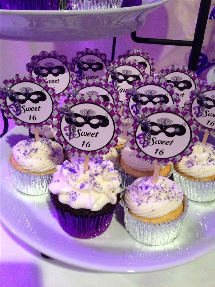 My masquerade sweet 16 cupcakes. Turned out amazing!! I printed the toppers and used sparkle paint to make them  pop! Ordered silver and purple foiled liners. Love the result. They were a hit at the party!!