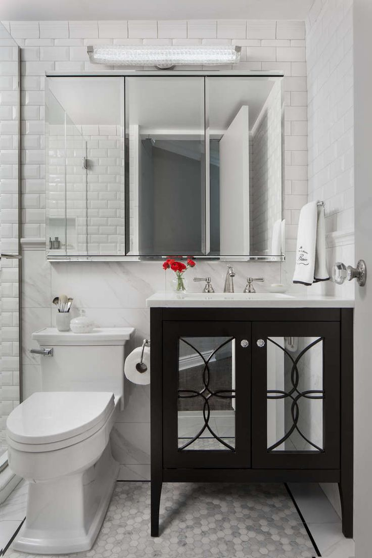 The 25 best transitional medicine cabinets ideas on pinterest a robern medicine cabinet crystal vanity light fixture and toto toilet white beveled subway tiles are laid out above the ceramic chair rail doublecrazyfo Images