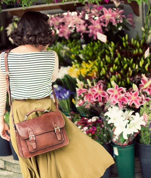 curls, midi skirt, striped top, brilliant satchel bag. ideal everyday.