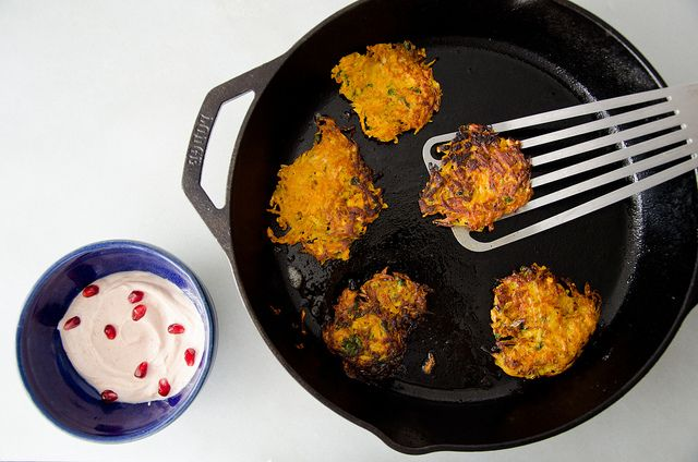 curried sweet potato, carrot, and parsnip latkes with harissa yogurt.