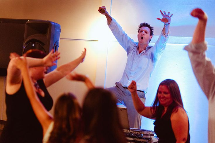 The DJ gets into it at a wedding by Scott McDonald