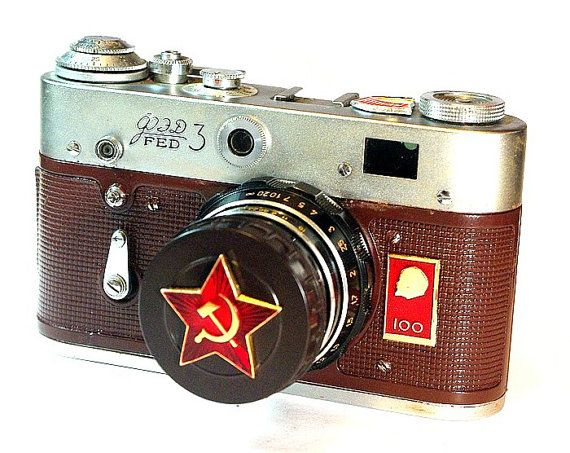 """LEICA copy RUSSIAN FED-3 with an  """"Industar-61"""" Lens. The camera was released a year ahead of the 100th birth anniversary of Lenin. The top of the body of the camera has a Vladimir Lenin bas-relief with the Inscription """"100"""""""