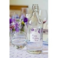 """Make Bottled Beverages Bloom with Purple Rose Arched Labels:  People, like roses, need water when they get parched. Now they can quench their thirst with beautifully decorated water bottles that bring new meaning to """"a cool drink of water."""" Create your own bouquet of bodacious bottles using water-resistant Avery Textured Arched Labels and serve at your next brunch, shower, or social gathering. Also great as a wine label—create a personalized bottled gift for the host of the next dinner…"""