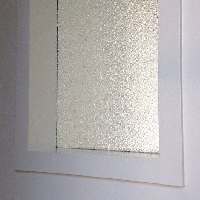We have a little window in the hallway near the boys' bedrooms that consists of a fixed pane of decorative glass. At night the light from the building next door illuminates this window like a lantern helping the kids find their way to the bathroom. Happy accident #nonightlightrequired