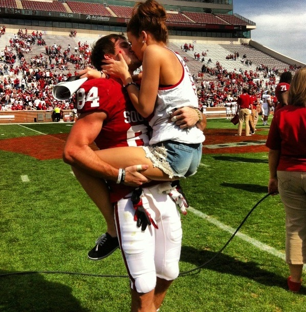 Football Girlfriend Life - Kisses after a touchdown . Love