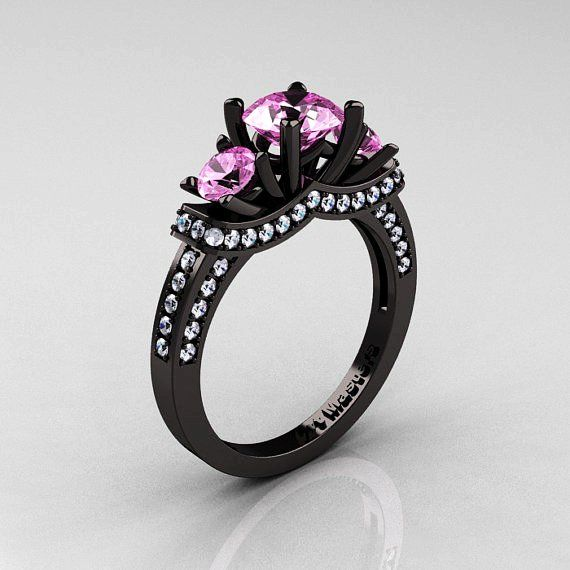 black ring with pink stones ring finger