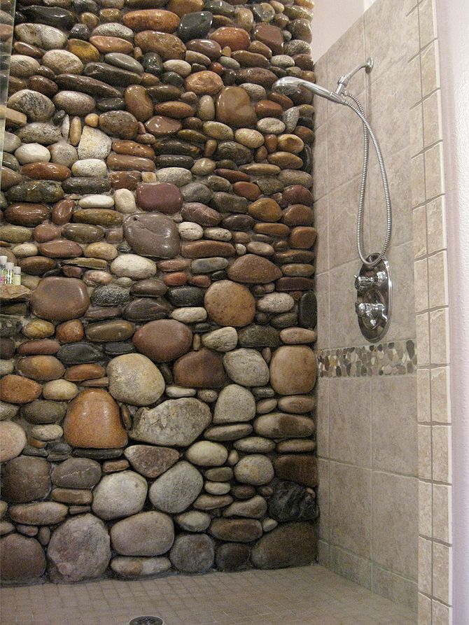 rustic rock look (Not sure what it is but not caring for the rock with man made tiles)