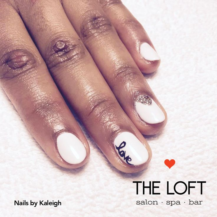 White manicure with gold sparkles and the word love in writing on an accent nail by Kaleigh at The Loft in Winnipeg.