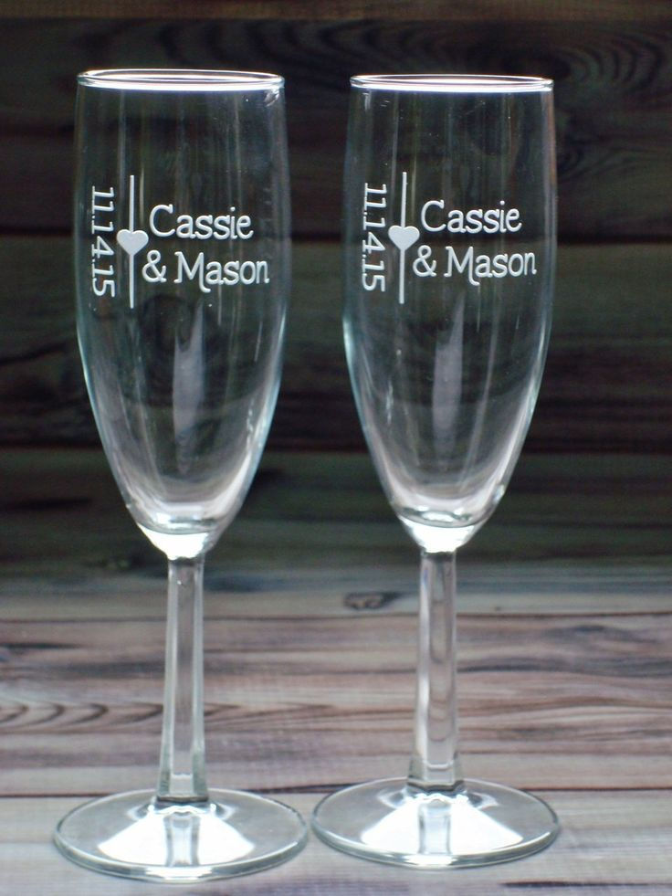 Wedding Couple Gift Toasting Flutes Wine Glass Set with Faceted Stems | Personalized with Names and Date. The price is for two toasting flutes/champagne glasses. These clear toasting flutes are sandblasted with the first names and date of the couple. Each glass holds 5.75 oz. and stands about 7-1/2 inches tall with a square cut stem. They make an elegant addition to the bridal table. Great wedding gift! Our personalized items are hand crafted by using a vinyl mask and then sand blasted for…