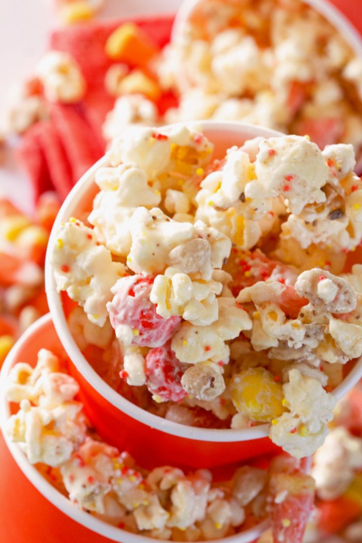 halloween popcorn mix (almond bark, popcorn, candy corn, peanut, toffee) ++ deliciously yum