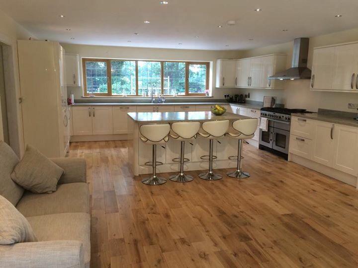 Modern kitchen gloss cream grey worktop Corian Howdens
