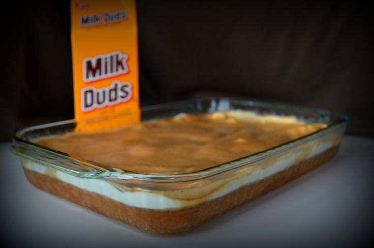 Milk Dud Cake! My mom made this for me for my birthday! Sooo good! It has melted Milk Duds on the top (: