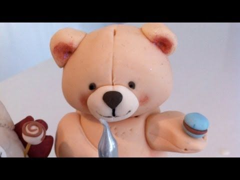 Step by step instructions for how to make a fondant teddy bear for a cake topper.    See the finished cake: http://www.howtocookthat.net/public_html/my-babies-1st-birthday-cake-the-fondant-decorations/  For fondant basics: http://www.howtocookthat.net/public_html/sugar-paste-fondant-cake-decorations/    How to Cook That is a dessert cooking channel ...