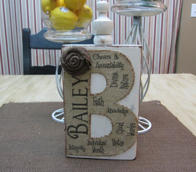 This is such a neat idea--a piece of burlap printed with descriptive words and attached to a finial!! So clever (and easy!)