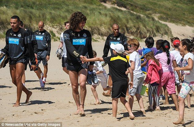Making friends: Fabricio Coloccini greets children after a quick dip in the freezing cold ...