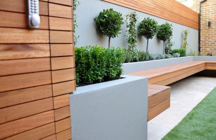 bespoke storgae in hardwood slats raised beds render block walls bench in hardwood garden designer london