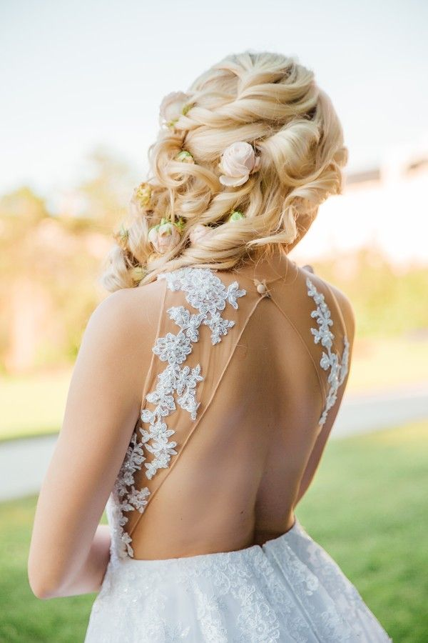 Wedding dress with naked back and lace details.