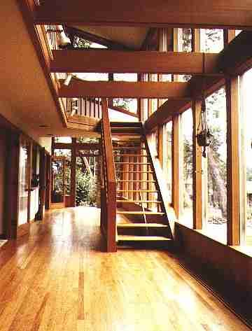 Sunroom with stairs to a loft level shows lighting on for Two story sunroom