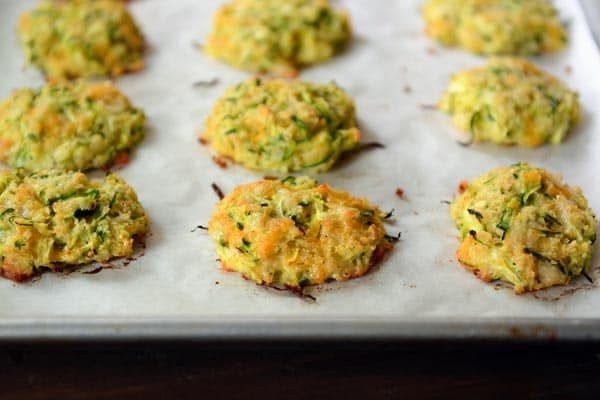 Simple and delicious, these baked cheesy zucchini bites are so easy to make and are a healthier alternative to a classic fried zucchini fritter!