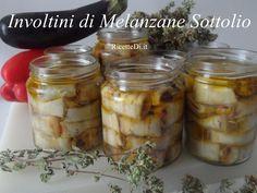 ecco la bellissima foto ricetta degli Involtini di melanzane sottolio. 24 ore sotto sale + 24 ore sotto aceto. Nel ripieno tonno, alici, capperi e olive