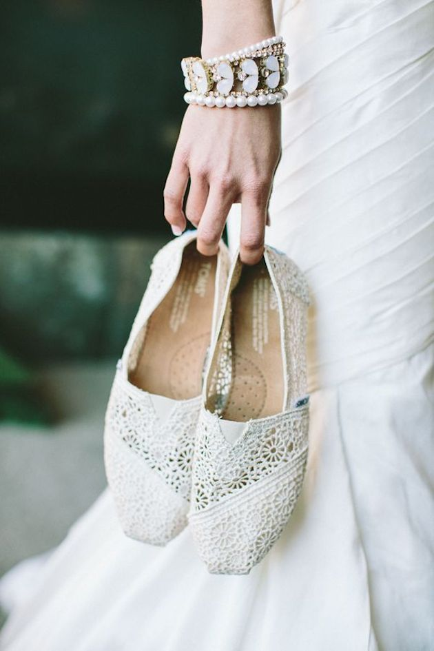 White lace TOMS are perfect for a summertime wedding.