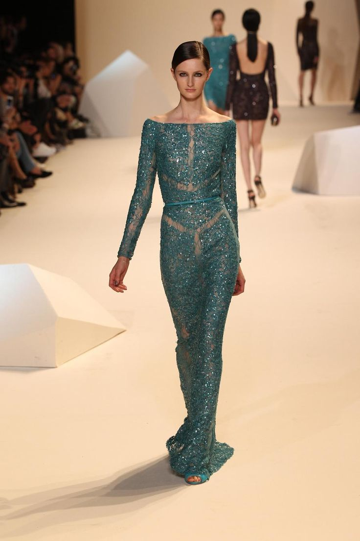 Elie Saab's sequined blue form-fitting gown with lace inlays is one design that certainly stood out the most; it was very elegant and chic! Description from beautywithintv.com. I searched for this on bing.com/images