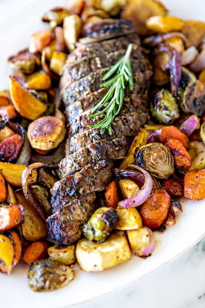Dinner just got super quick and easy thanks to this sheet pan meal featuring roasted pork, carrots, golden beets, red onion, Brussels Sprouts, and parsnips. This recipe for Fall Sheet Pan Pork Tenderloin with Honey Balsamic Roasted Vegetables was created in partnership with @smithfieldfoods #realflavorrealfast