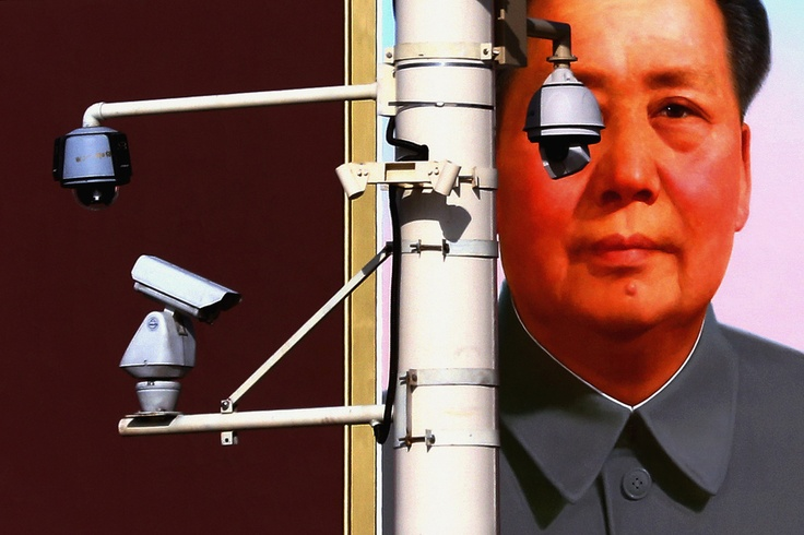 Security cameras and portrait of former Chairman Mao Zedong in Tiananmen Square, Beijing, China