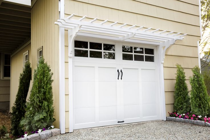 Use milled brackets and pressure-treated lumber to create an elegant canopy over your garage door