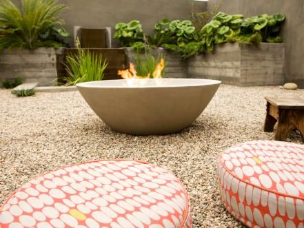 "When choosing an outdoor fire pit, ""look for heavier materials, nothing flimsy,"" advises Lou. ""And you'll need to cover your fire pit when it's not in use."" Design by Laidlaw Schultz Architects; Photography by John Ellis."