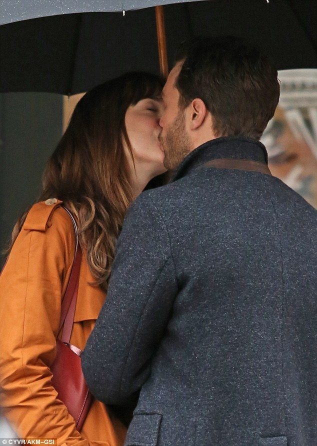 Erotic hit: The costars shared a kiss as they got into character as Anastasia Steele and Christian Grey