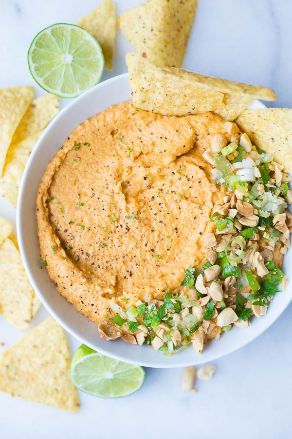 This Thai Peanut Hummus is filled with Thai peanut sauce ingredients like Sriracha, garlic, and ginger! A healthy gluten free and vegan snack!