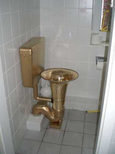 Tuba toilet - can you imagine the echoes? Pinterest home decor fail!