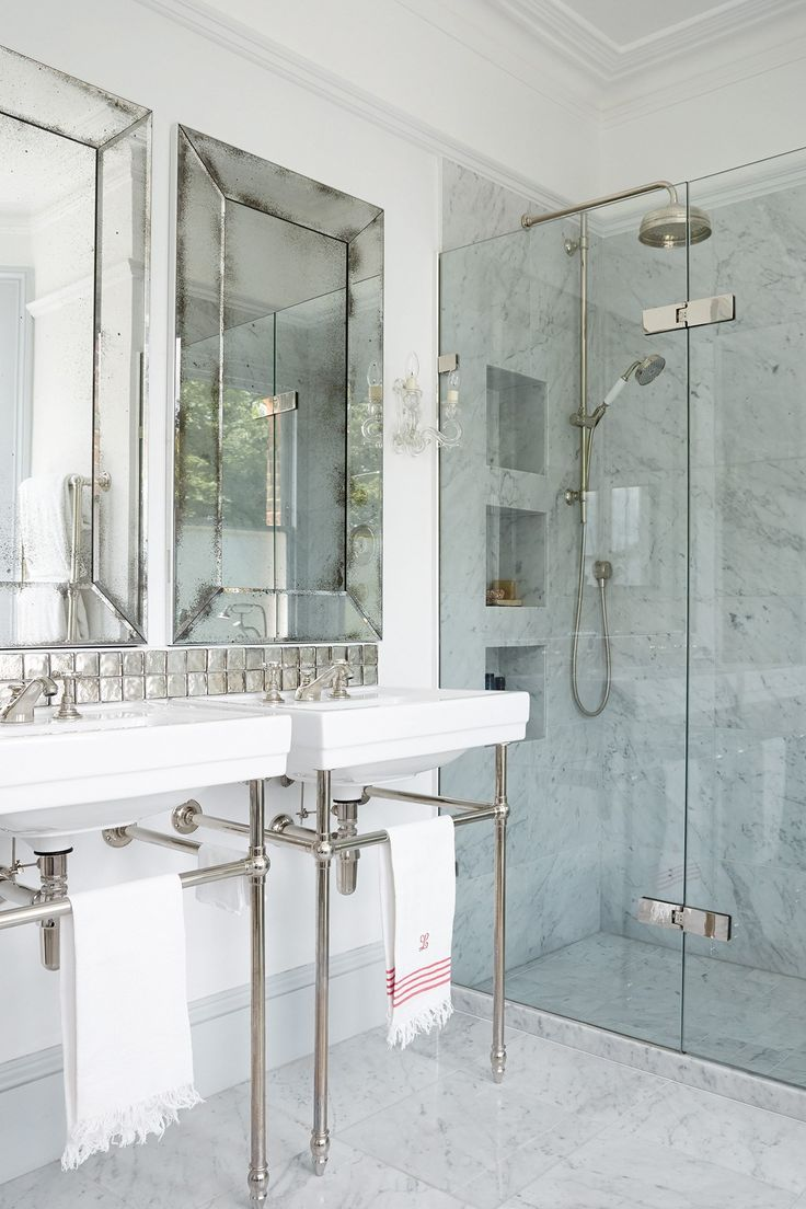 The large mirrors and tall towel rails create the illusion of space, and compliment the bathroom accessories.
