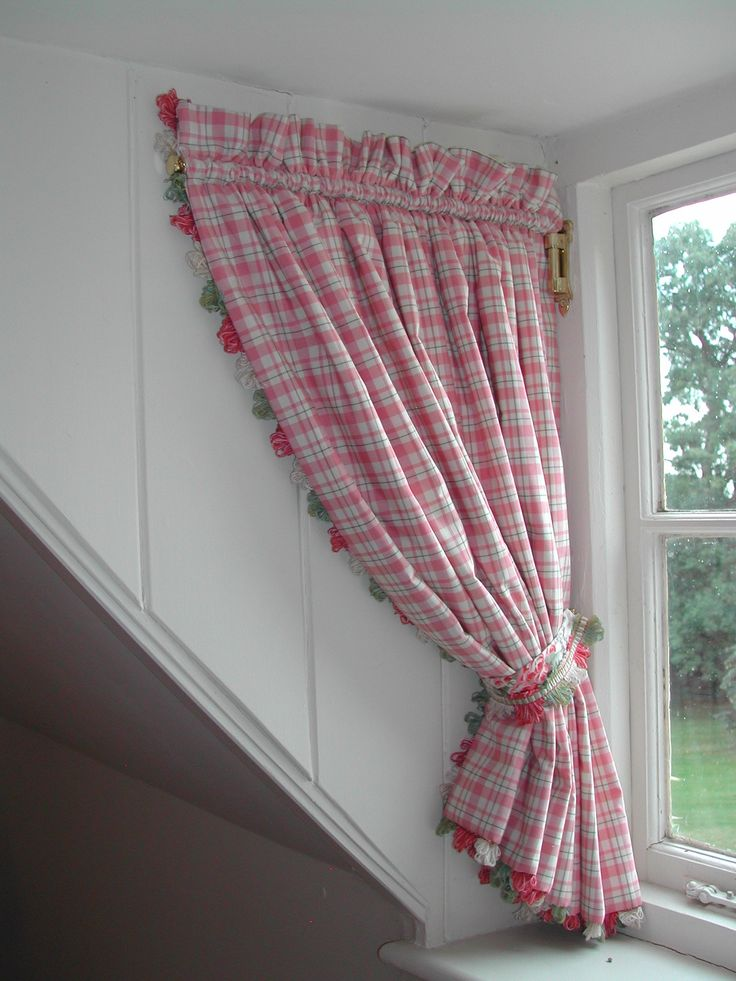 Curtains on a swing arm for dormer window. I dont like THESE curtains but I like the idea.