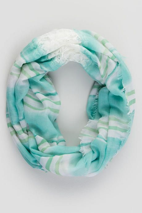 The Lisette Loop Scarf features a mixed mint stripe pattern with panels of ivory lace on each side. Perfect for an easy spring outfit!