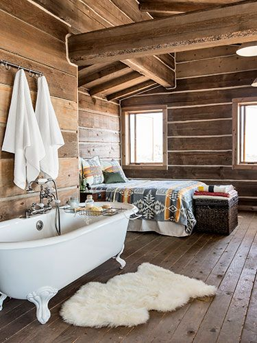 """The cabin is furnished with everything that's necessary—and nothing more. No fancy appliances grace the kitchen, but there is a vintage claw-foot tub in the bedroom. """"The house has a certain simplicity to it that's beautiful,"""" Bueno says."""