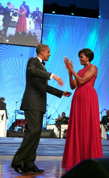 "Michelle Obama Barack Obama Photos Photos - (AFP-OUT)  President Barack Obama and first lady Michelle Obama arrive at the annual Phoenix Awards Dinner sponsored by the Congressional Black Caucus Foundation at the Washington Convention Center, on September 18, 2010 in Washington, DC. The president said in his speech to the group ""I need you because this isn't going to be easy,""  referencing the November elections. - President Obama Attends Phoenix Awards Dinner"