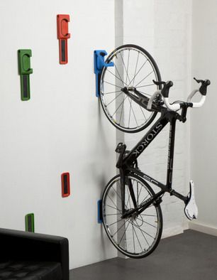 "this two part system hooks the front wheel & supports the rear as both lie flat against the wall... ""endo"" by cycloc"