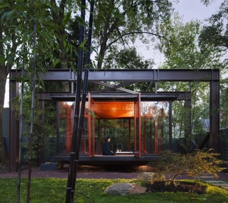 TEA HOUSE/ by David Jameson Architect Architecture/ Bethesda/ United States/ 2009/ A hanging bronze and glass object inhabits the backyard of a suburban home.  The structure, which evokes the image of a Japanese lantern, acts as a tea house, meditation space, and stage for the family's musical recitals.
