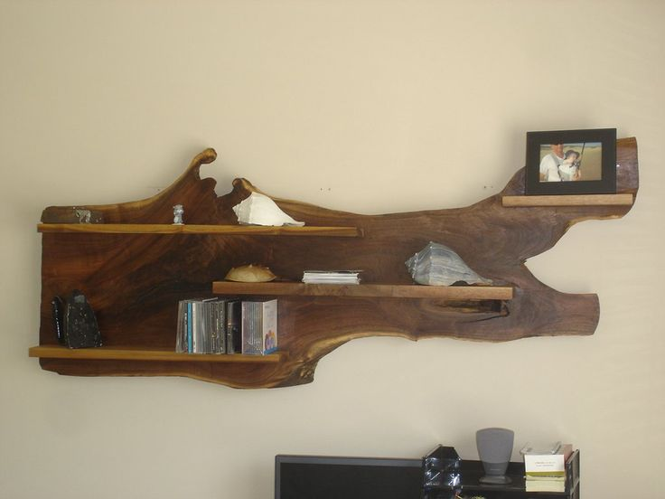 Step up your standard shelving with this chic, unique wooden wall shelf ($575) made from walnut wood.