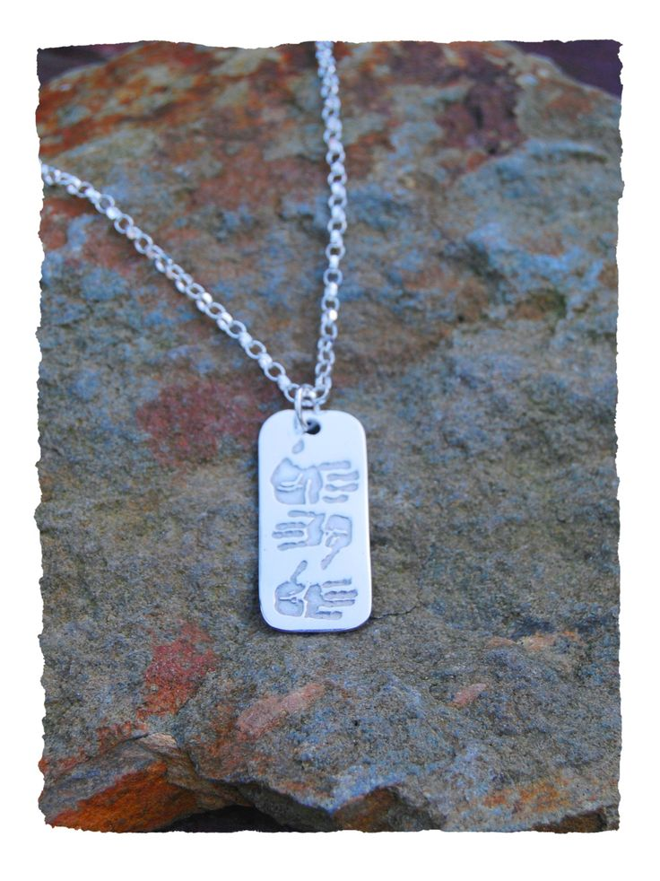 Hand crafted triple print dogtag pendant is a fashionable way to show off your loved one's handprints or footprints.  The pendant is suitable for men and women.   The dogtag pendant will hold three prints (handprints or footprints) on the front and is a stunning way to keep the people you love close.