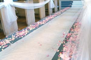 I like the flowers lining the aisle and then the ribbon to just line the aisle.