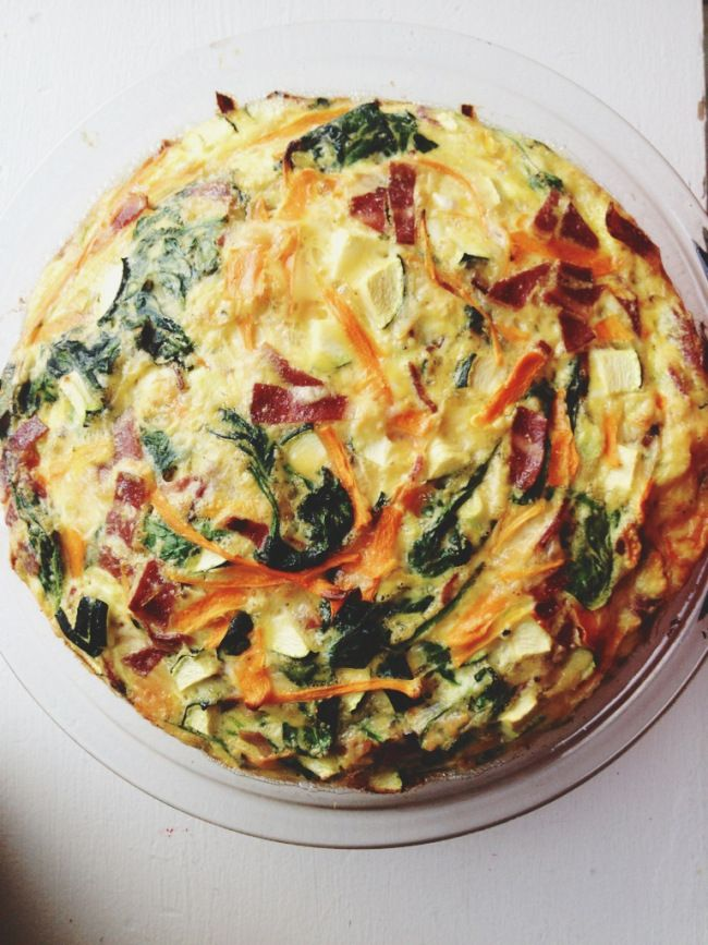Amazing Crustless Quiche with spinach, bacon, and smoked cheddar