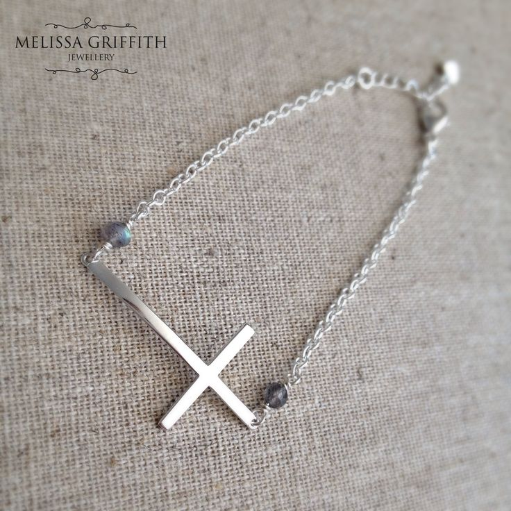 Sterling Silver Sideways Cross Bracelet (MGB108) $38.00 This timeless bracelet features a sterling silver sideways cross and two labradorite rondelles on either side. Cross measures 17x32mm. Fits a 6-7 inch wrist (1 inch extender).