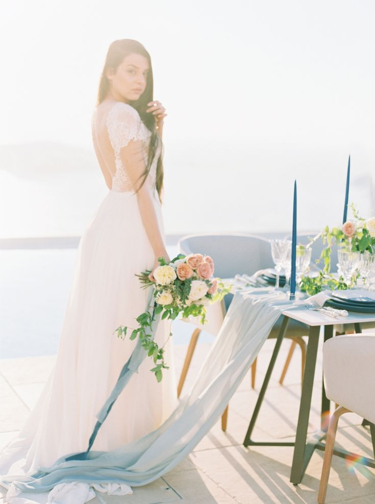 Floral Design: Betty Flowers Santorini - http://www.bettyflowerssantorini.gr Wedding Dress: Marianna Kastrinos - http://mariannakastrinos.com/ Photography: Trynh Photography - www.trynhphoto.com   Read More on SMP: http://www.stylemepretty.com/destination-weddings/2017/06/23//